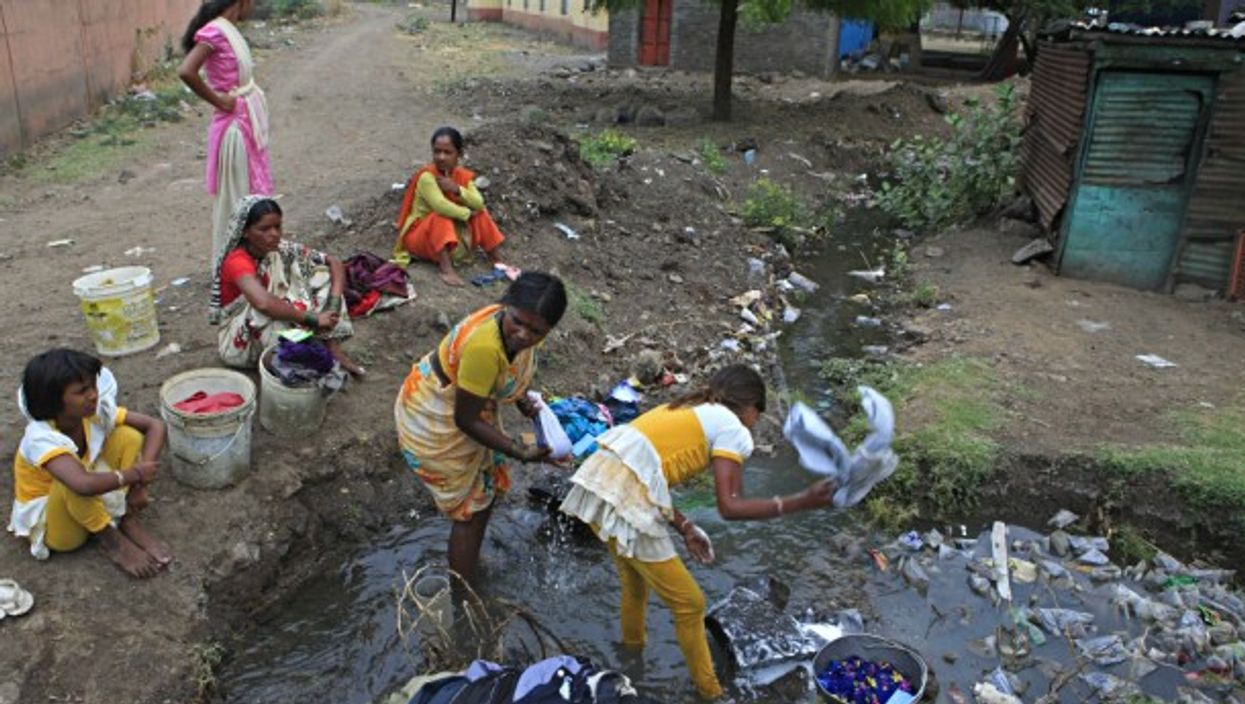 Villagers in a drainage system