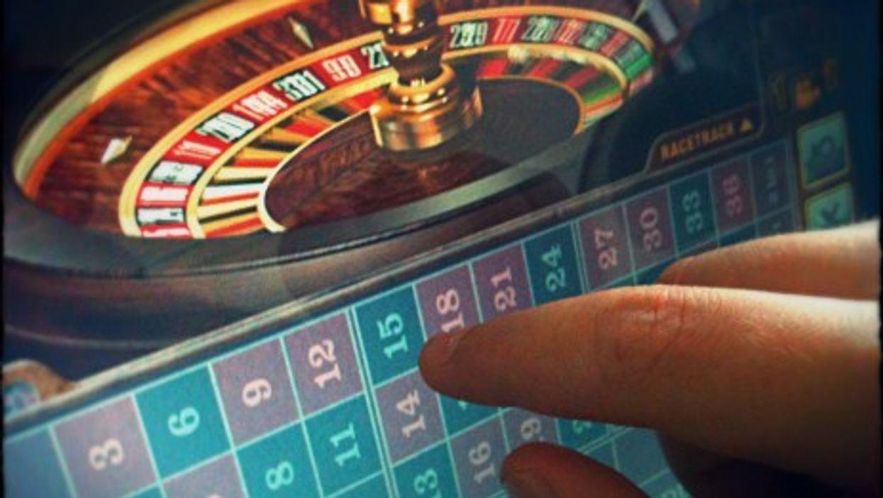Virtual roulette wheel, real debt
