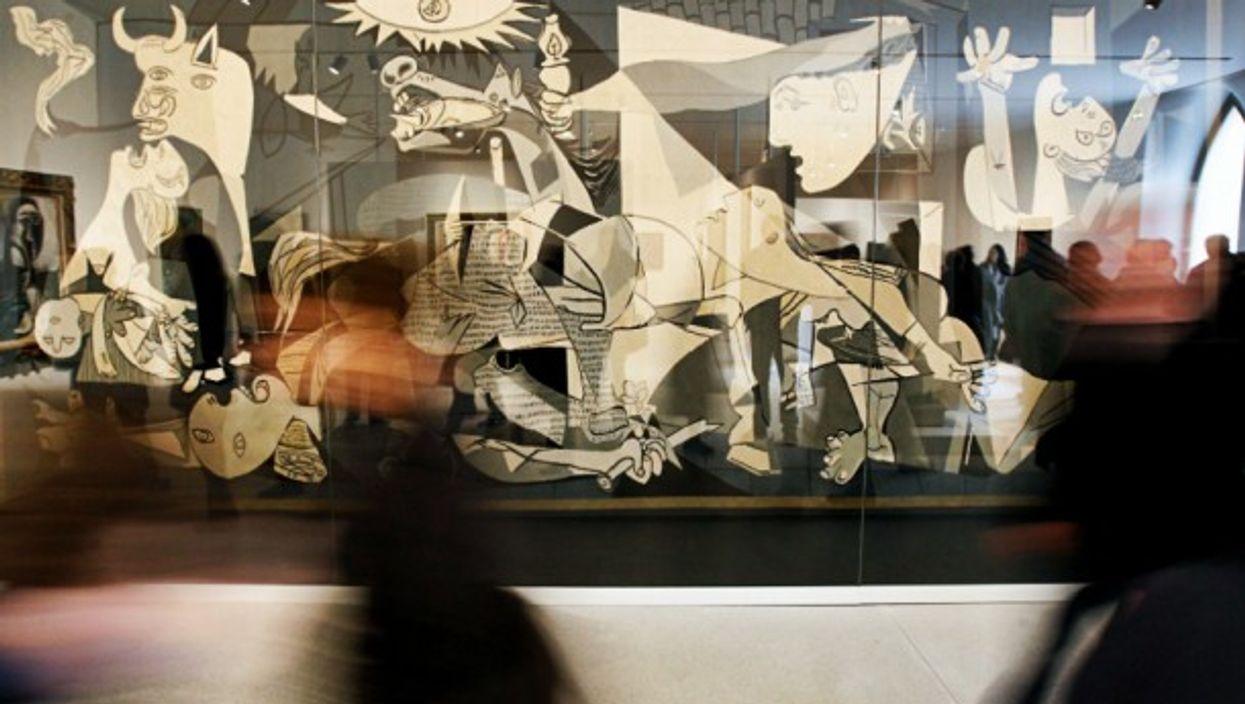 Visitors walking past Guernica