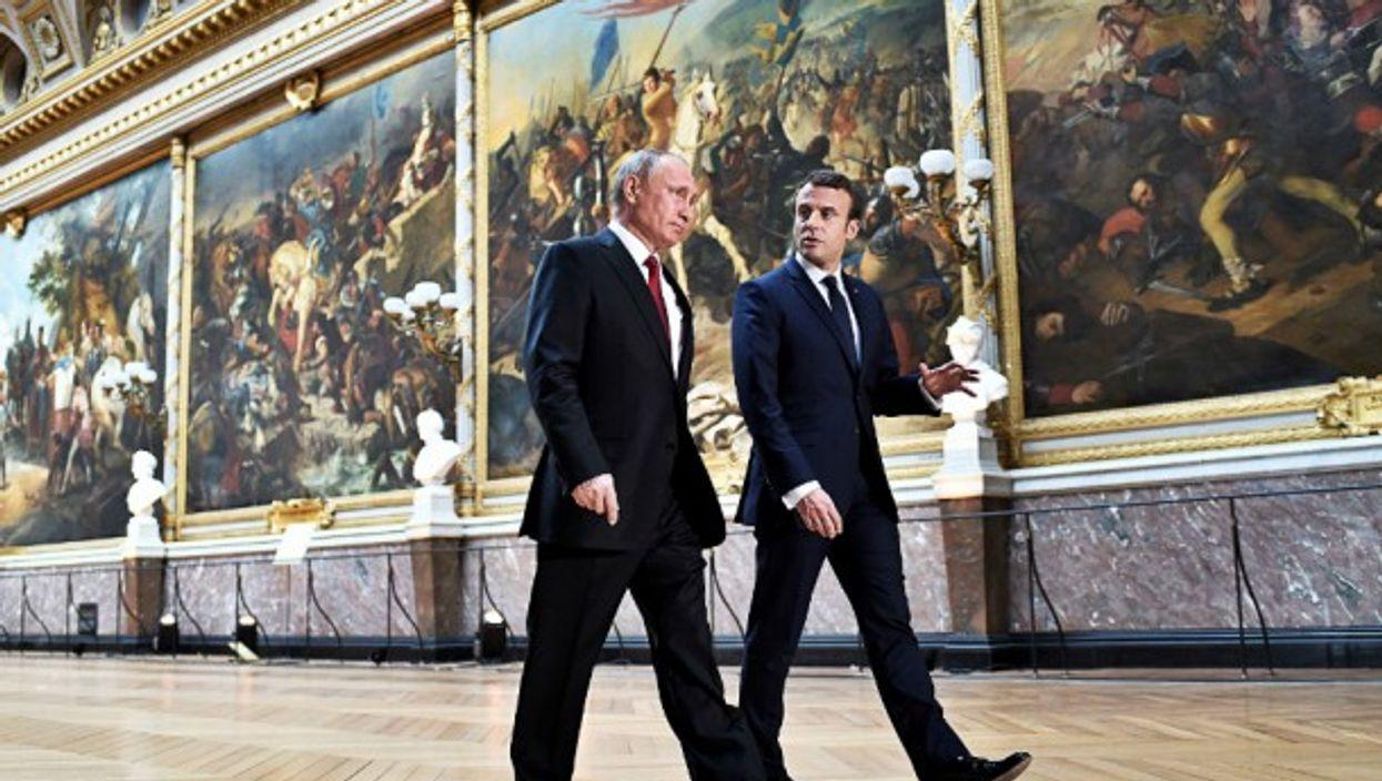 Vladimir Putin and Emmanuel Macron during their meeting in Versailles, on May 29