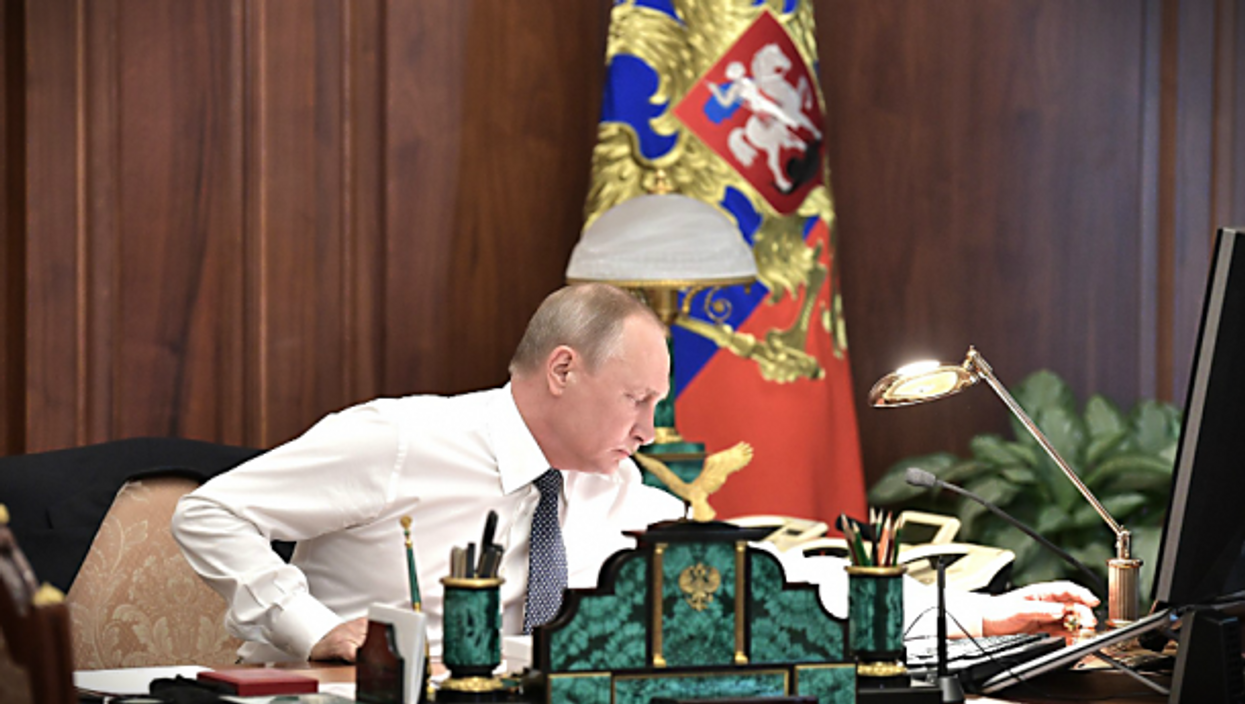 """Vladimir Putin, the """"godfather"""" of the current batch ofstrongmen."""