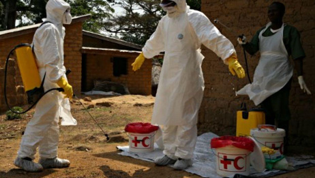 Volunteers battling Ebola in Gueckedou, Guinea, in April 2014