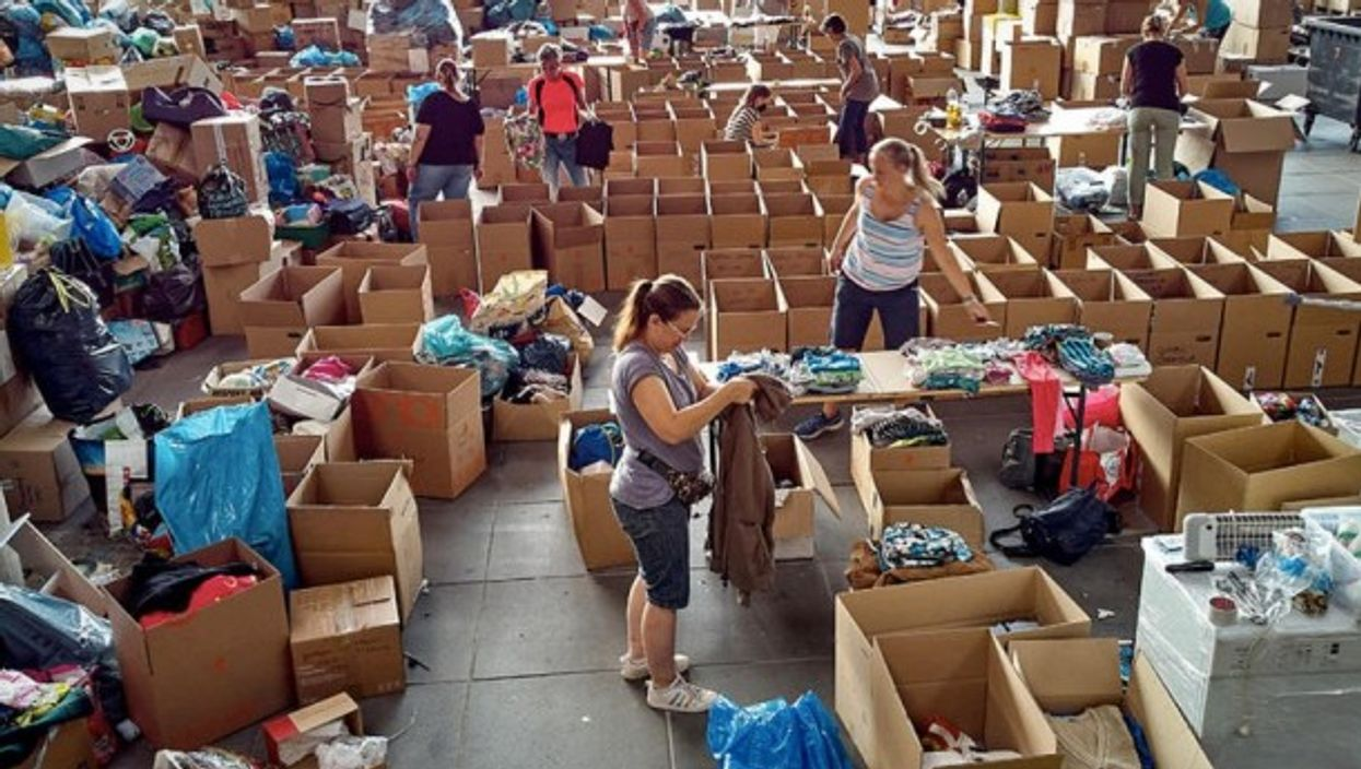 Volunteers separate items at the Nurburgring donation center after Germany's devastating flooding