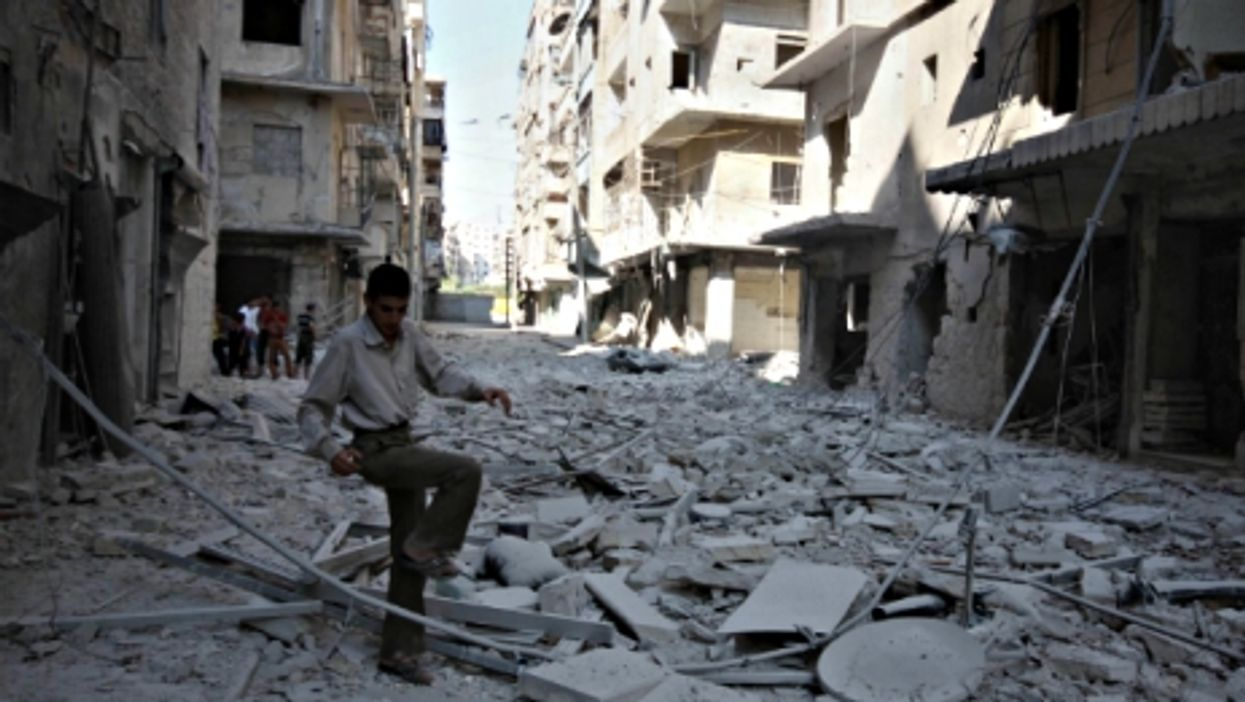 Walking on the rubble of Aleppo, Syria