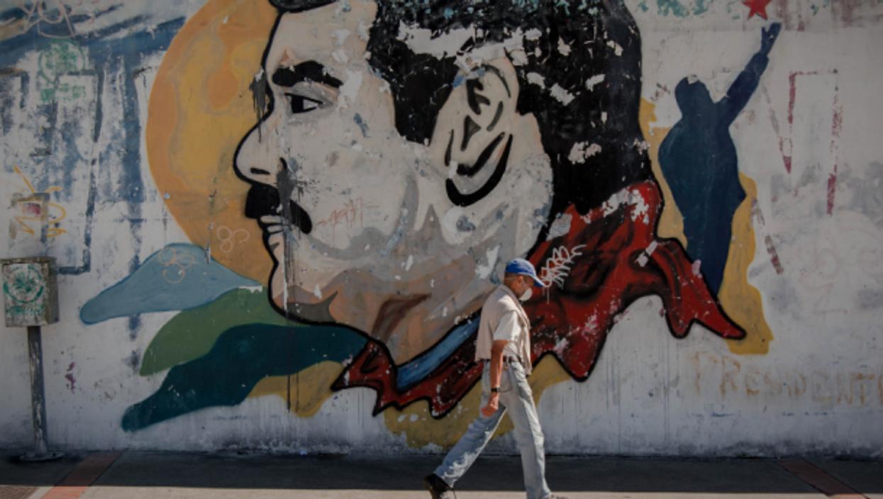 Walking past a Maduro mural in Caracas, Venezuela