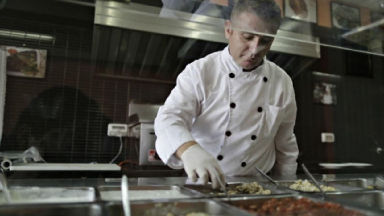Wareef Kaseem Hamdeo at his Syriana restaurant in Gaza