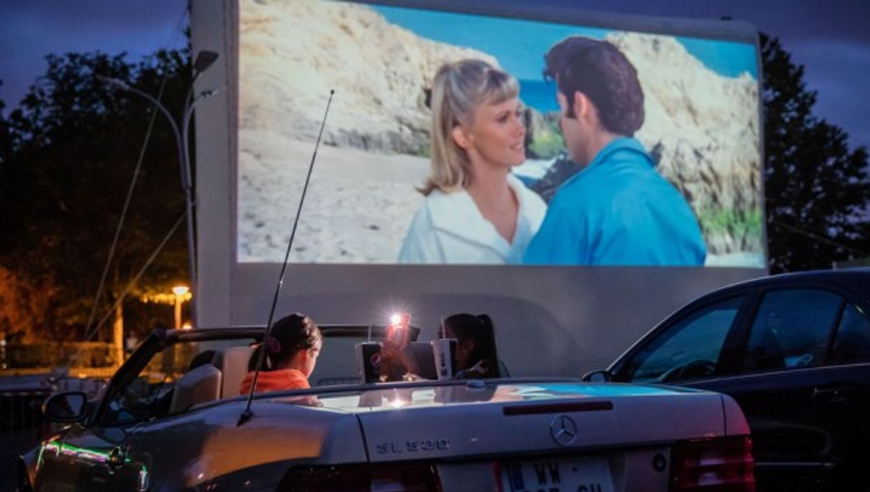 Watching a movie at a drive-in theater