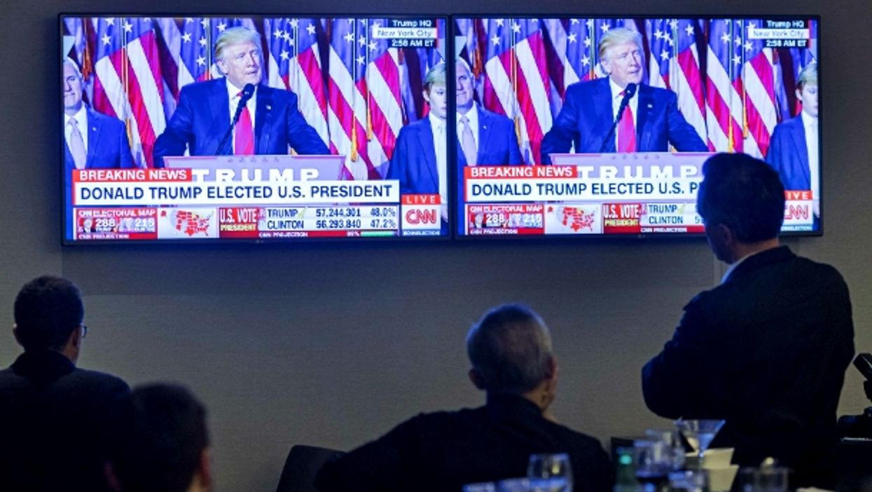Watching coverage of the election in New York