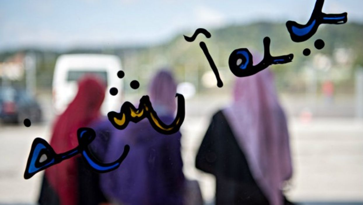 'Welcome' written in Farsi at a migrant reception center in Tubingen, Germany