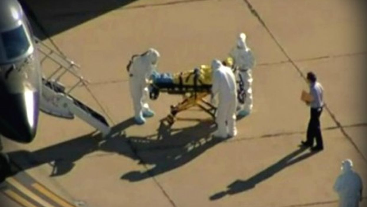 Who is this reckless clipboard man at Dallas airport Ebola scene?