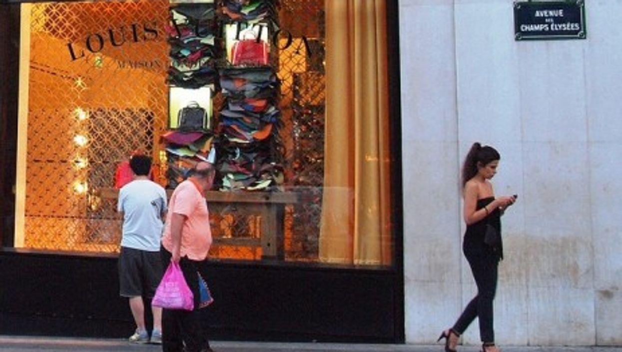 Window shopping along the Champs-Élysées in Paris