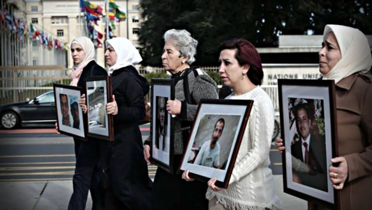 With photographs of 'disappeared' loved ones in front of Geneva peace talks
