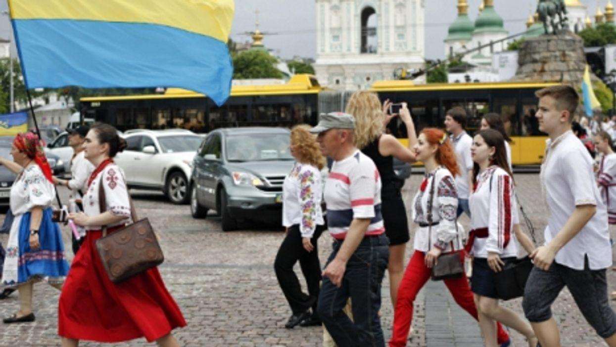 Woman marching in a parade in Kiev, Ukraine