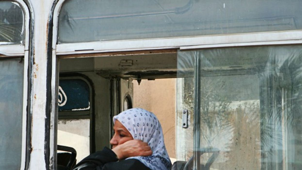 Woman on a bus in Cairo