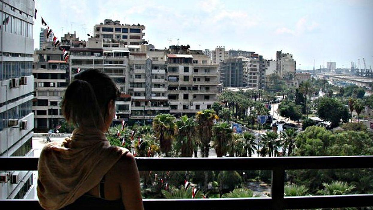 Woman on balcony in Latakia, Syria