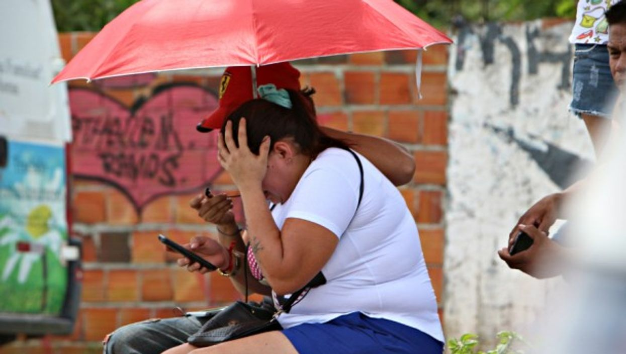 Woman reacting to the prison killings in Manaus on Jan. 2