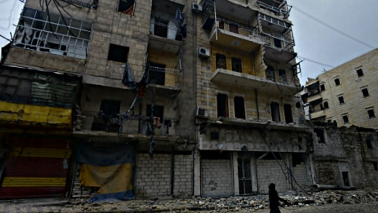 Woman walking in Aleppo, Syria