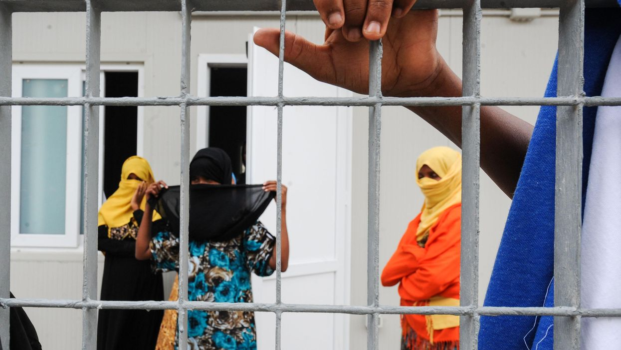 Women at a migrant reception center in Lampedusa, Italy