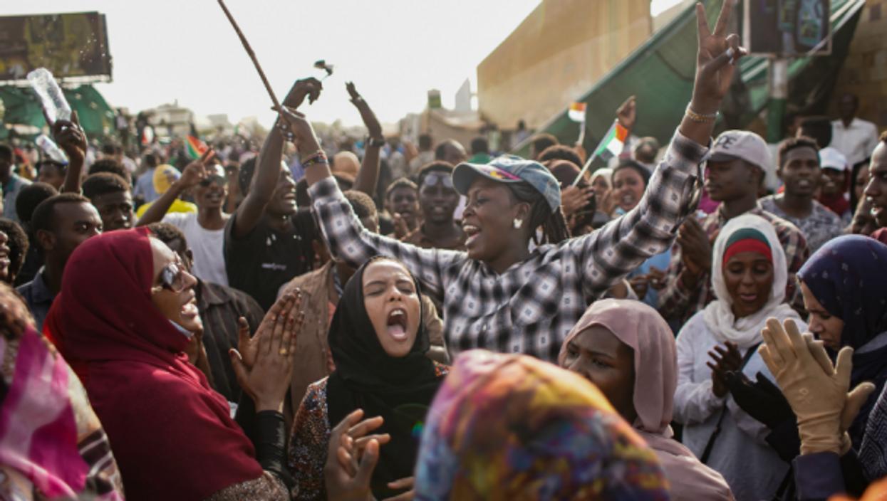 Women celebrating  in Khartoum on April 11