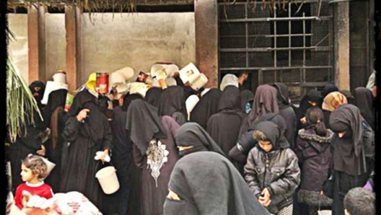 "Women wearing ""the shield"" in Raqqa"