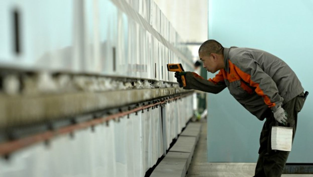 Worker at one of various glass enterprises that strengthened Chinese science, technology innovation and market research