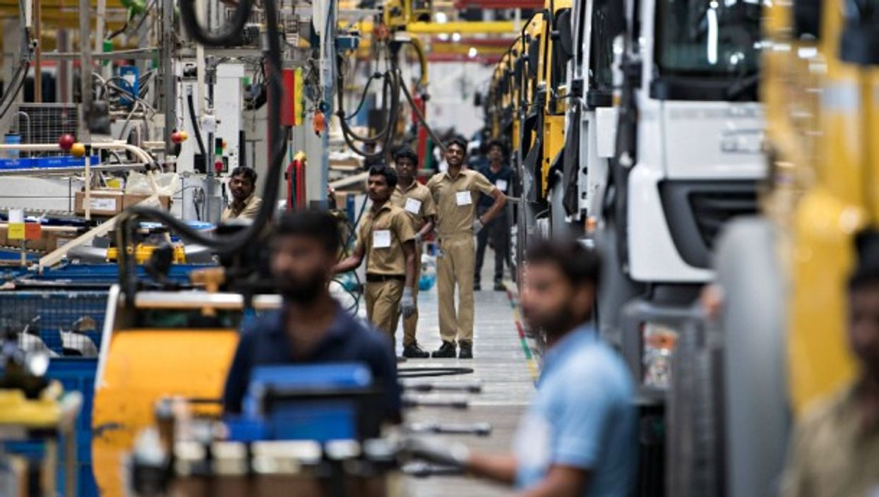 Workers at a car factory in Chennai, India