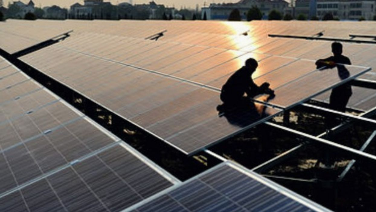 Workers at a solar power plant in China