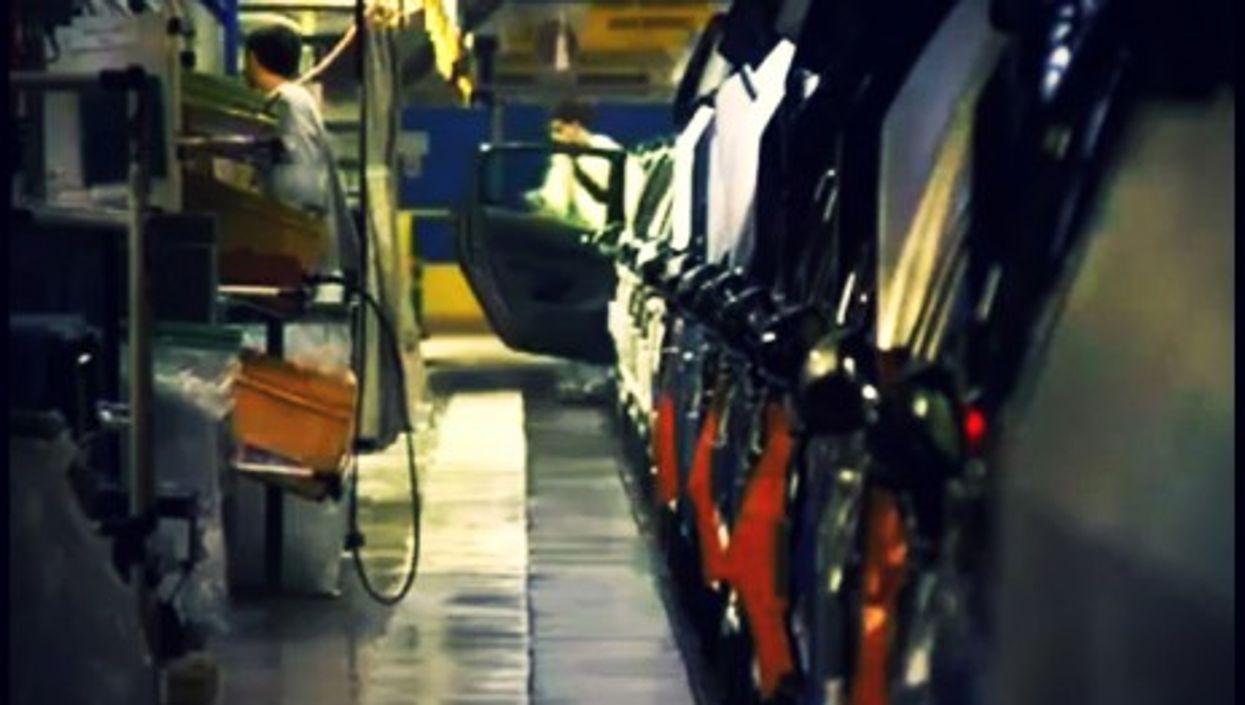 Workers at the Sochaux-Montbéliard Peugeot factory