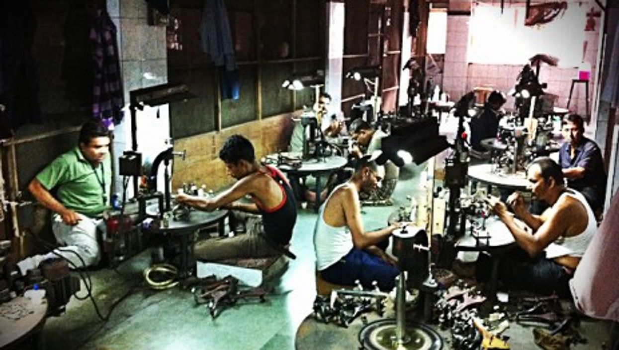 Workers at the Surat diamond factory