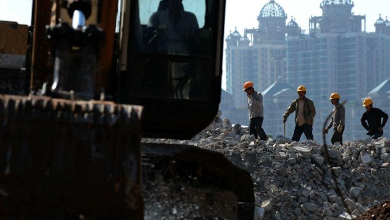 Workers dismantle buildings in Guangzhou