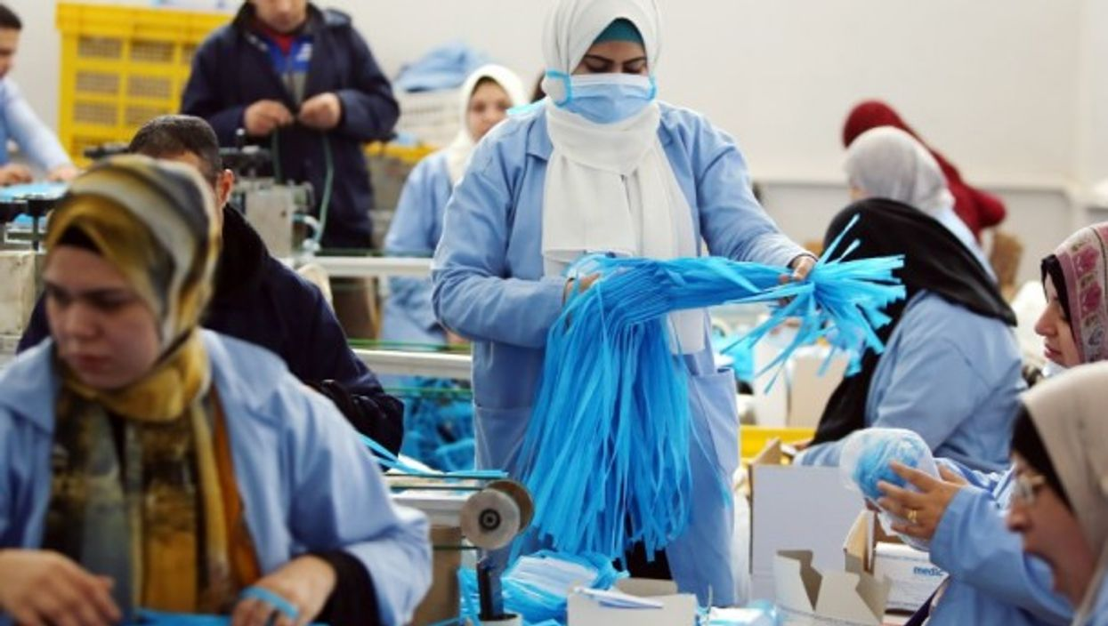 Workers in a factory that produces face masks in Monufia, Egypt,
