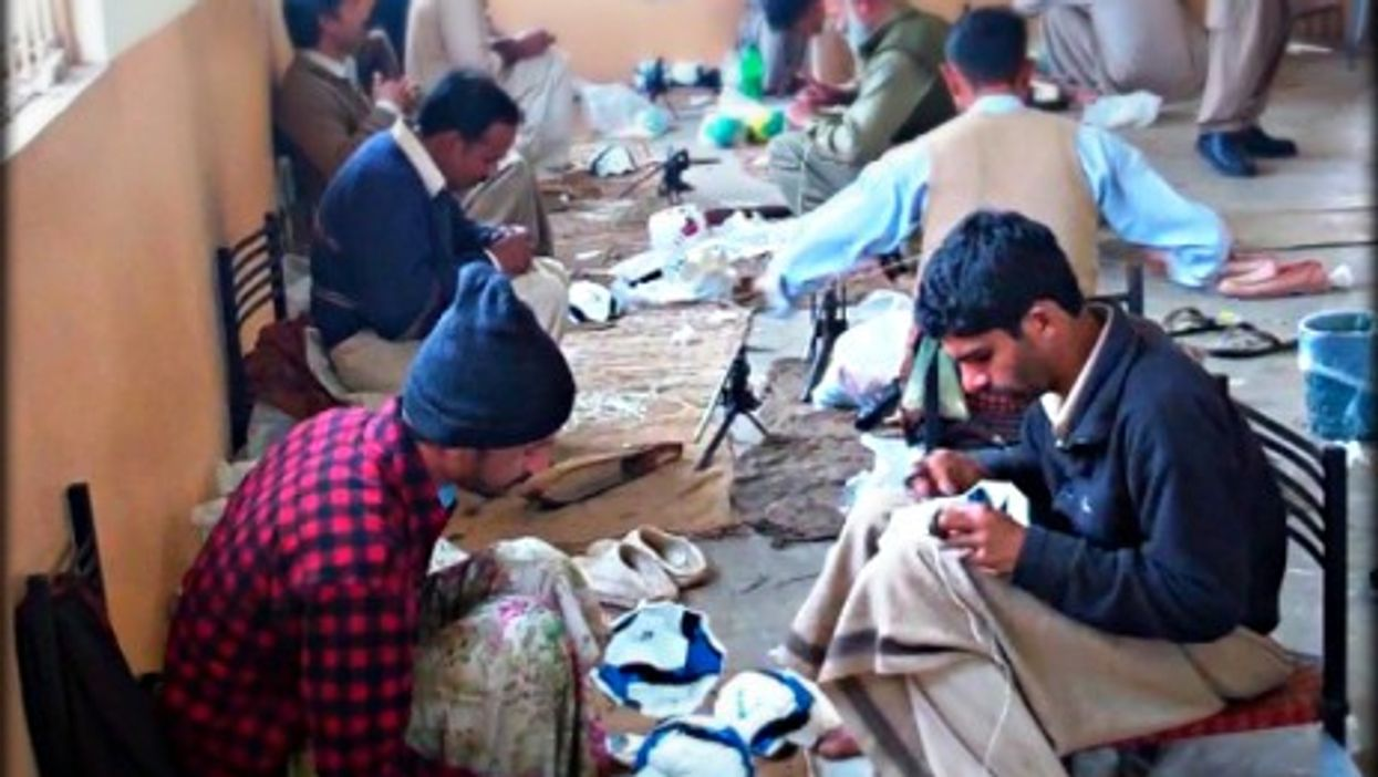 Workers in a soccer ball factory in Sialkot