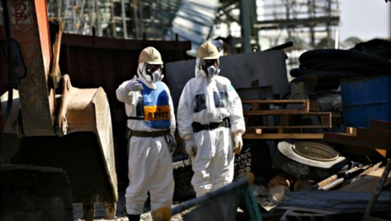 Workers next to Fukushima's No.4 reactor