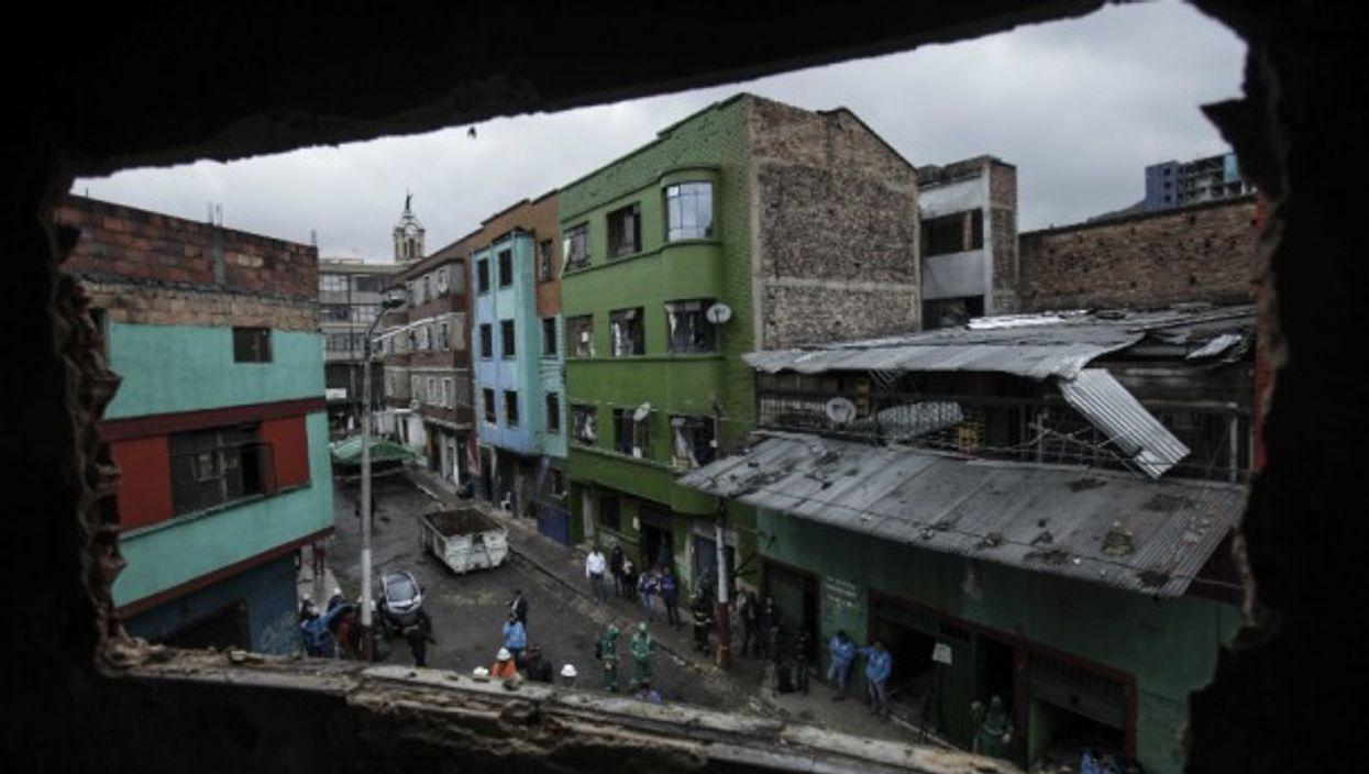 Workers prepare to demolish buildings in downtown Bogota in 2016.