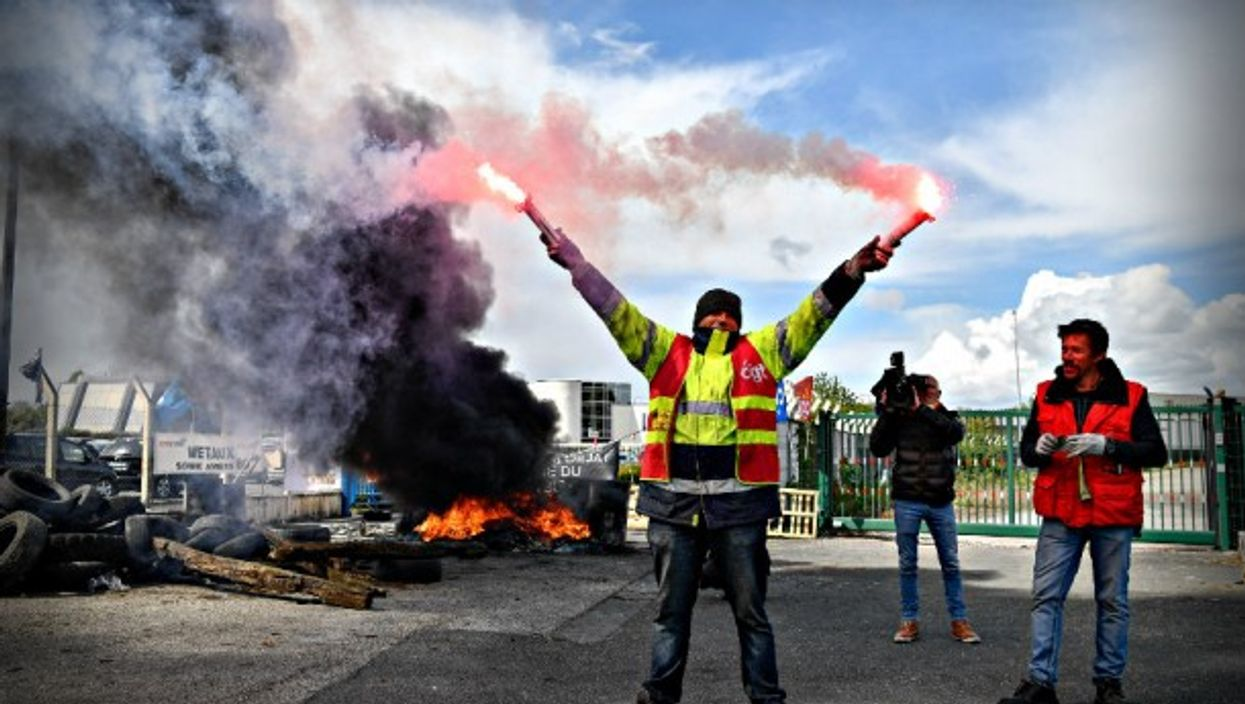 Workers protest at a Whirlpool plant slated for closure in France