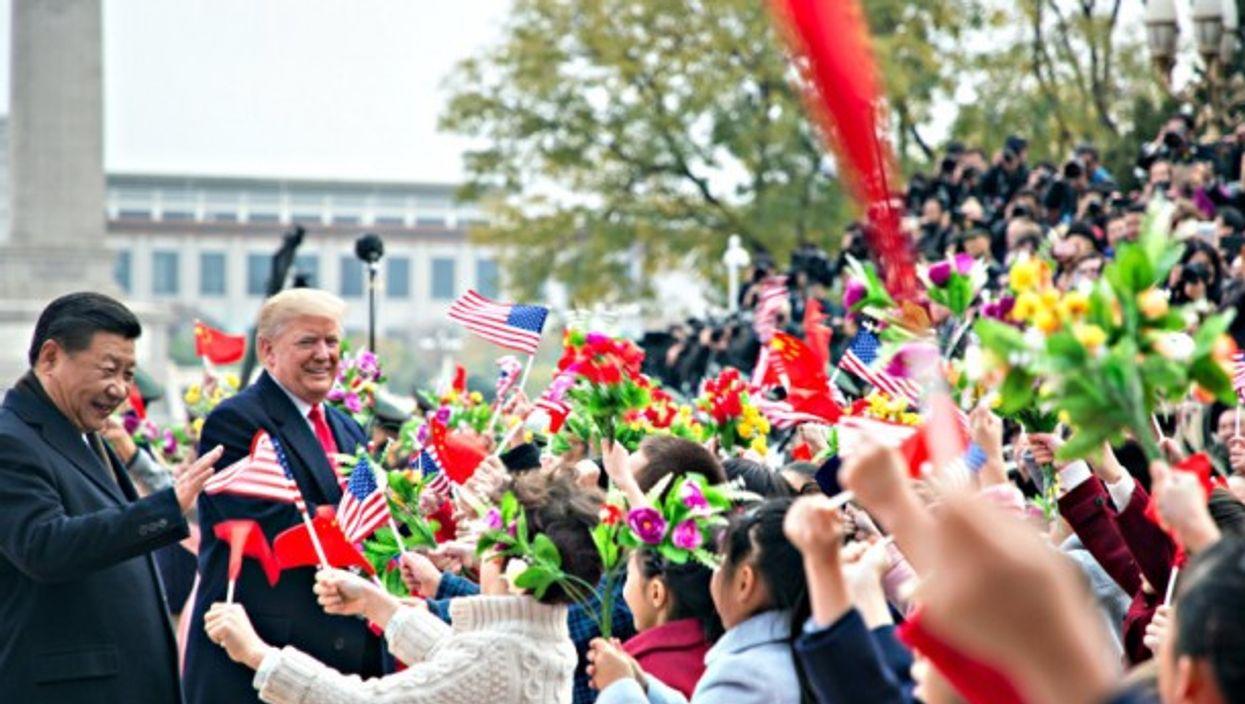 Xi and Trump meet school children last week in Beijing