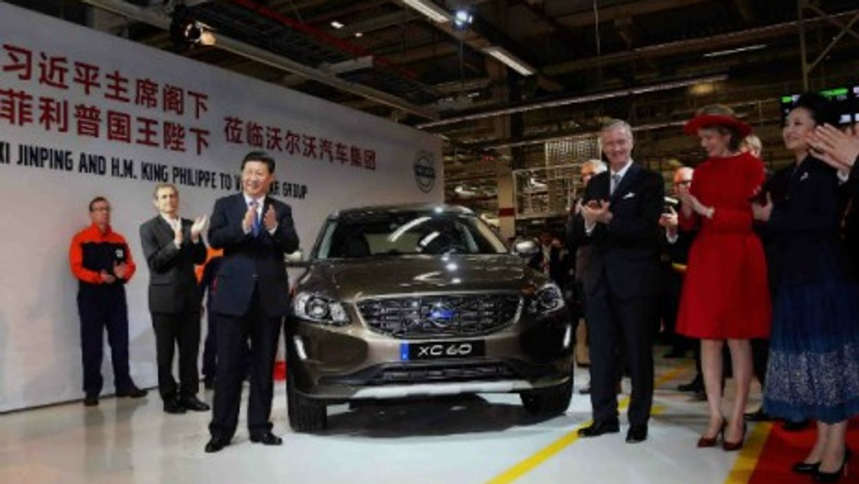 Xi Jinping and Belgian King Philippe unveil the 300,000th car to be exported to China during Xi's visit at Volvo's plant in Ghent.