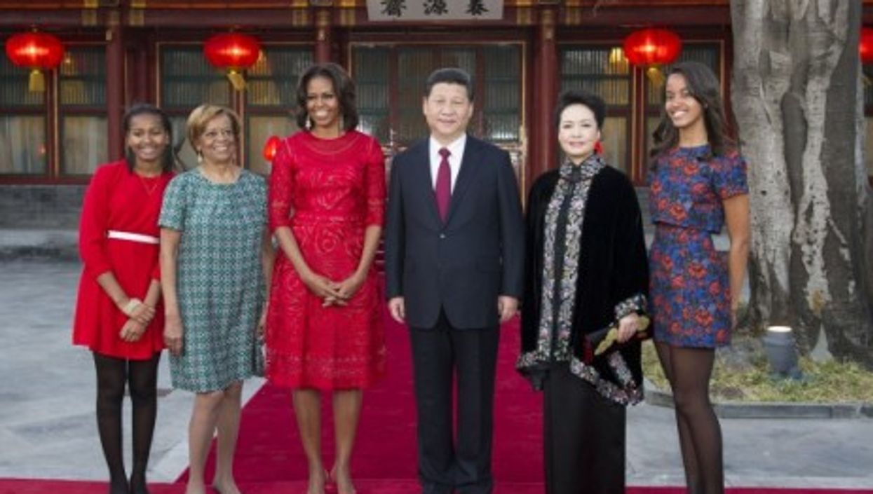 Xi Jinping and his wife with Michelle Obama, her mother and her daughters