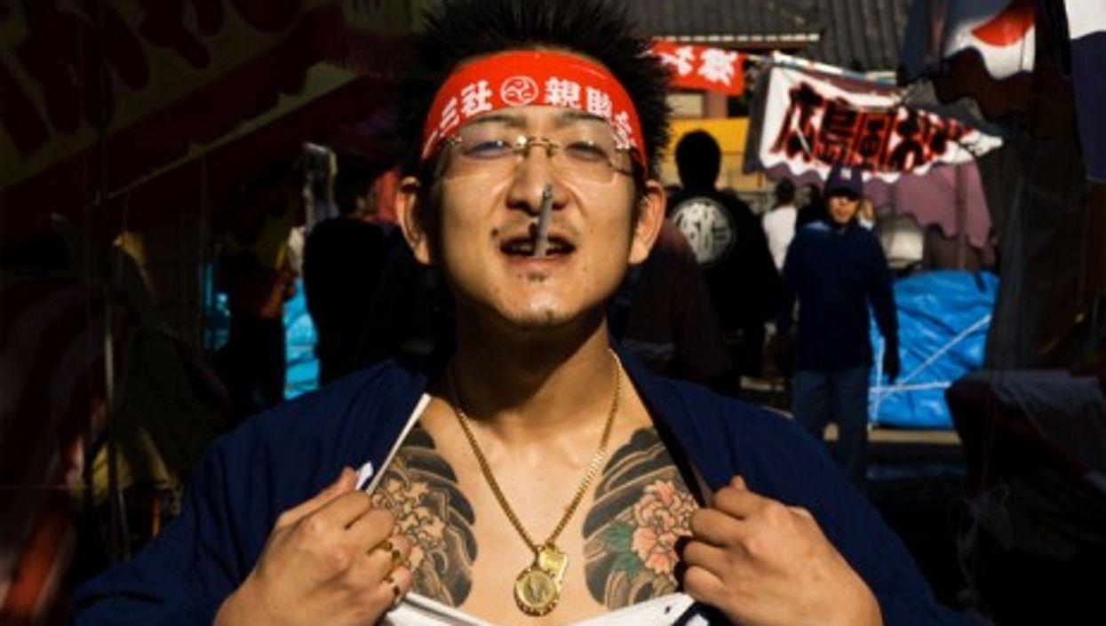 Yakuza showing off tattoos at the Sanja Shrine festival in Tokyo