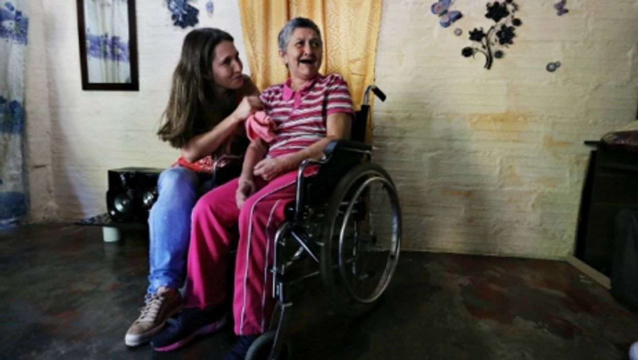 Yaned's mother has Alzheimer's and can no longer walk on her own.