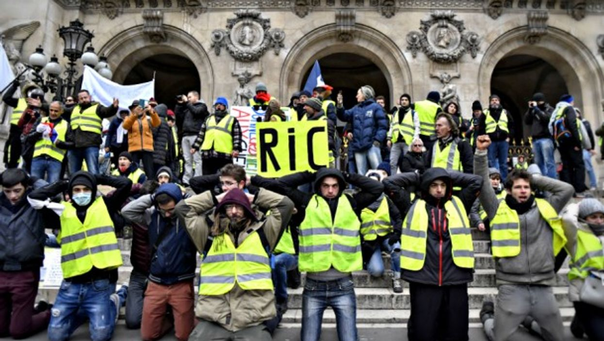 Yellow vests protest in front of Paris' Opera on Dec. 15