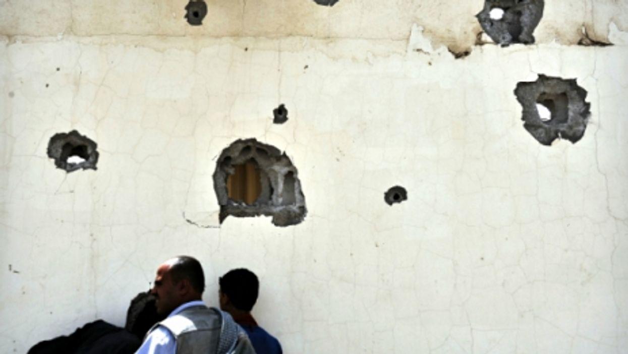 Yemenis in Sanaa after heavy shelling on July 10