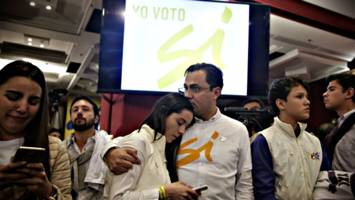 Yes supporters in Bogota react to referendum results Sunday.
