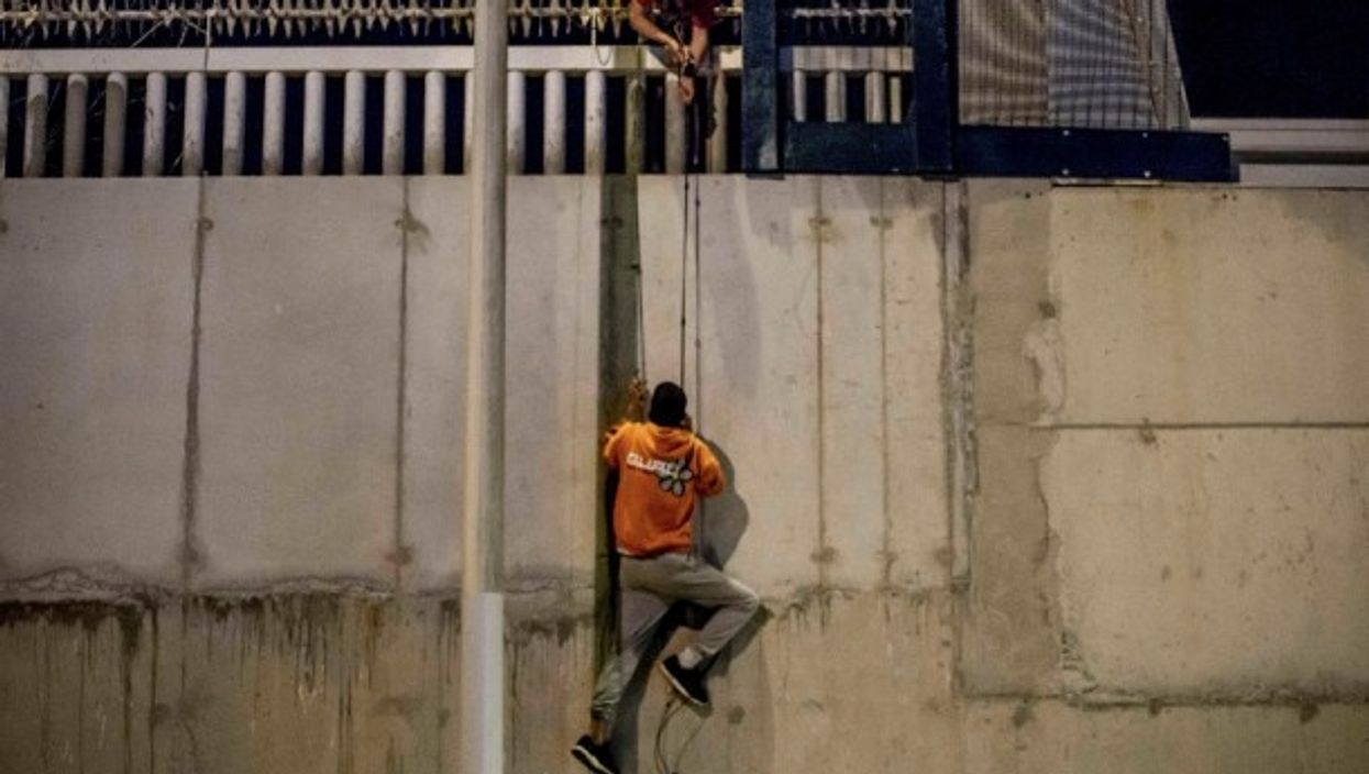 Youth attempt to enter Spanish territory through the North African enclave of Ceuta  May 21