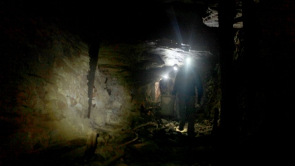 Zama-zamas search for gold in a disused mine shaft in Roodepoort, South Africa.